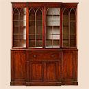 Книжный шкаф из красного дерева в английском стиле эпохи классицизма.